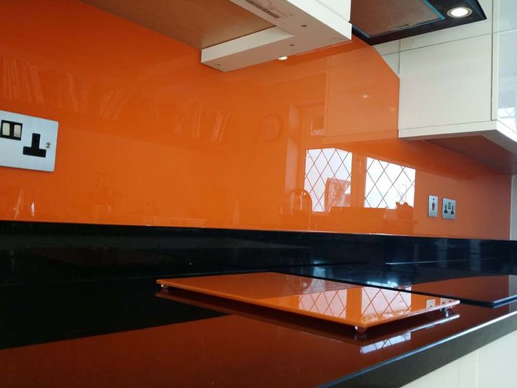 DIY Pure-Orange Kitchen Glass Splashback. You can specify the exact size for your kitchen and bathroom glass splashbacks or upstands. You can choose from the range of our standard stock colours which are CreoGlass best sellers. View more on www.creoglass.co.uk #kitchen