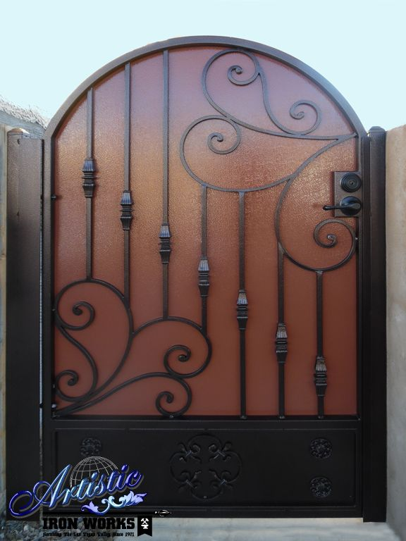 Scrolled wrought iron side gate with knuckles and solid back plate