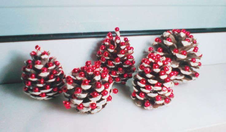 Diy cute little pinecones transformed into snowy trees with red Christmas ball. Perfect x-mas gift for both family and friends!