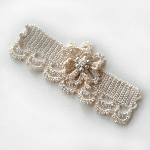 Crochet cuff bracelet.    *I THINK A RINESTONE BROOCH ON EITHER SIDE OF THE FLOWER WOULD LOOK AWESOME!!!  *A