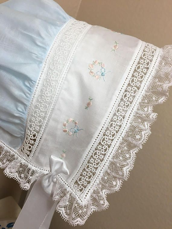 This bonnet is made from organdy and French laces. It features hand embroidered bullion roses and featherstitching. All garments listed are completed as described and pictured and ready to be shipped. Custom orders upon request if another size or garment is needed. Please send me a message describing your request and I can work up a price quote for you.