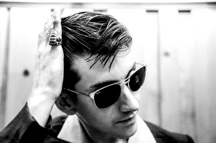 Hair, sunglasses, big collar, little finger ring