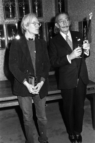 Andy Warhol and Salvador Dali at a screening of Shampoo. February 12, 1975