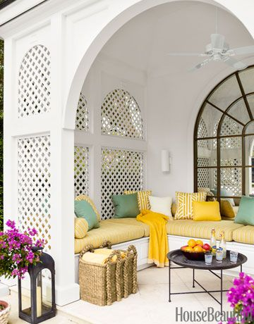 """In a Naples, Florida, house, the poolhouse, with cushions in Pollack's Shoreline fabric, """"was a cavern before we installed the mirror,"""" designer Jesse Carrier says."""