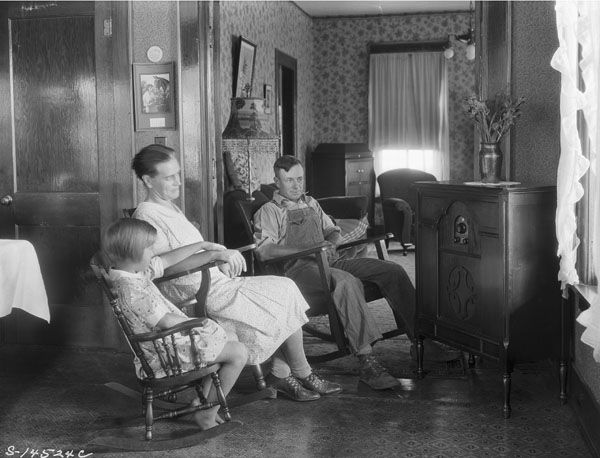 """Farm family listening to their radio"""