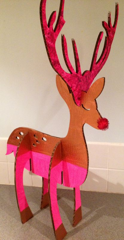 Lasercut festive cardboard reindeer in neon pink and bronze with glittery antlers.