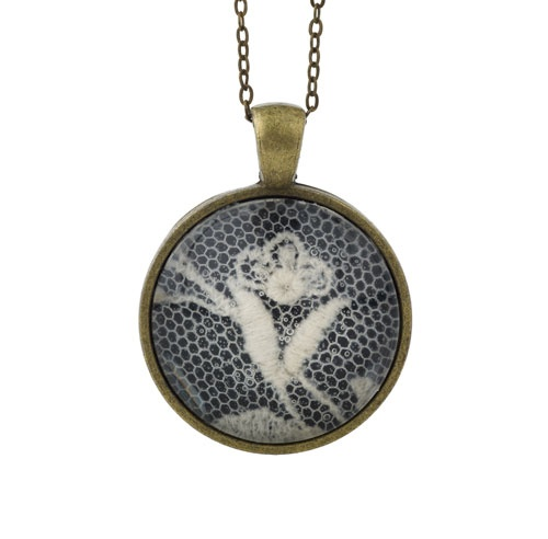 A hand-crafted necklace made using lace trims that date from the Elizabethan era, commonly known as 'Renaissance Lace'.  Own a piece of history by purchasing this one-off piece of jewellery. Each of the pendants are handmade and feature slightly different lace patterns.£25.00