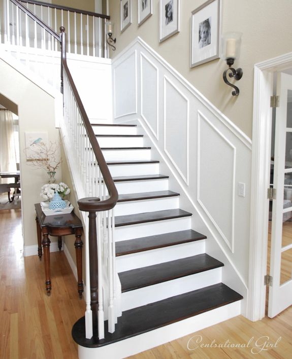 DIY:  Staircase Facelift - this tutorial explains how she stripped, sanded & stained her dated orangy oak wood staircase.  She lists the products used & steps taken to get this awesome look!