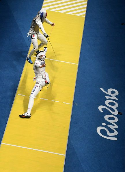 #RIO2016 France's Astrid Guyart competes against Russia's Inna Deriglazova during their women's individual foil quarterfinal bout as part of the fencing event...