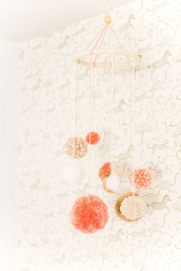 diy pom-pom mobile and animal wallpaper