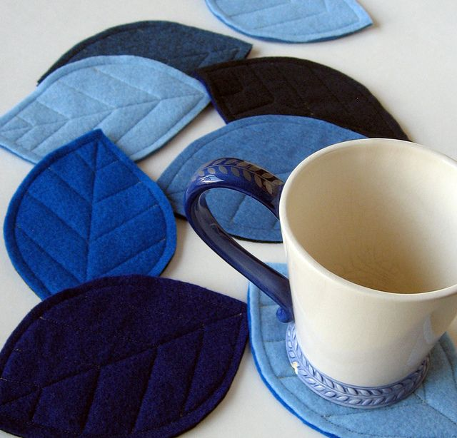 Felt leaf coasters set in shades of blue by pickychicky, via Flickr