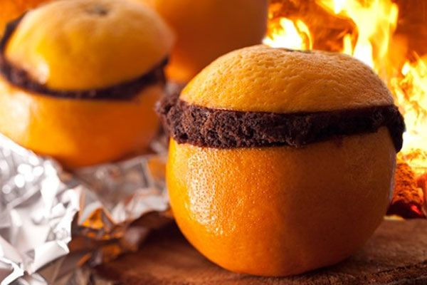 8 Must-Make Campfire Cooking Recipes: Campfire Quesadillas, Spider Sausages, Campfire Strawberries, Banana Boat, Campfire Cinnamon Rolls, Brownie Oranges, S'mores with a Twist, Campfire Cones