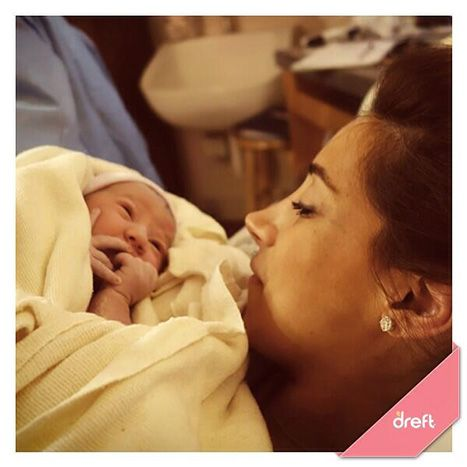 Danielle Jonas holds her new baby with Kevin Jonas, Alene Rose on Feb. 2