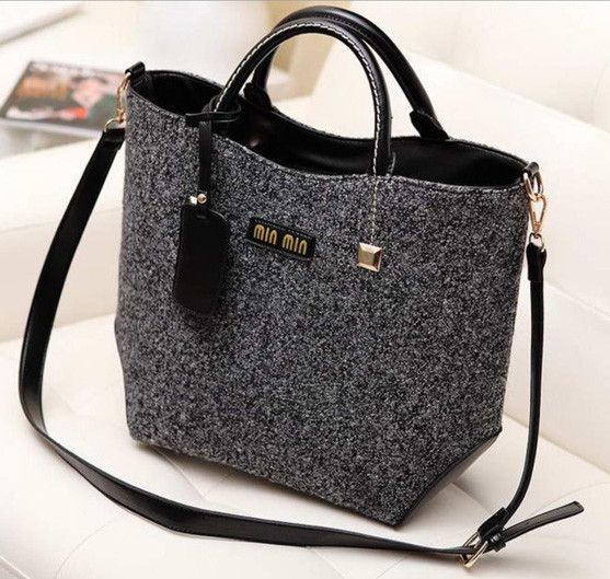 Women's classically designed woolen and PU leather handbag that also wears as a shoulder bag. A versatile yet sophisticated tote that's ready to carry you throu