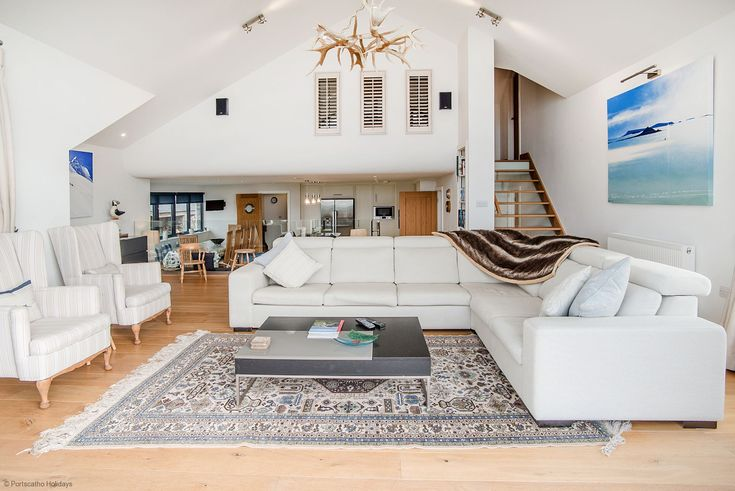 Dream living room - clean furniture and awesome minimalit decor from a luxury cottage in Cornwall.