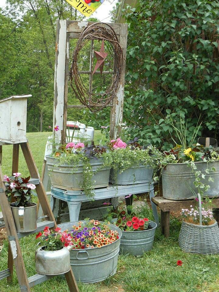 Country garden I love things planted in metal tubs, wine barrels, and giant planter boxes.