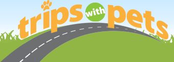 TripsWithPets.com -- type in your starting and ending cities, and it shows you pet-friendly lodging all along the way.