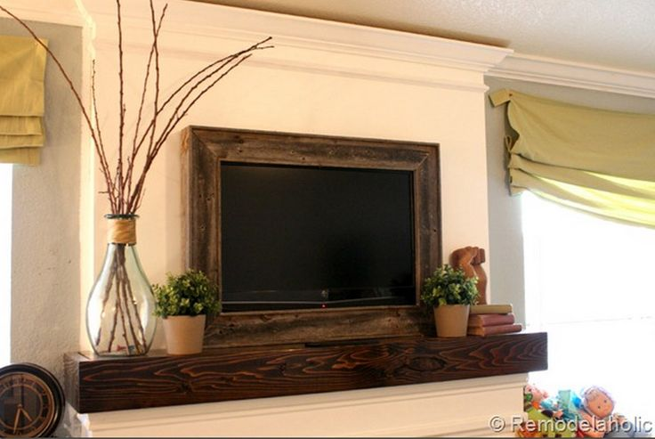 Salvaged Wooden TV Frame 8 Clever and Stylish Ways to Disguise Your TV