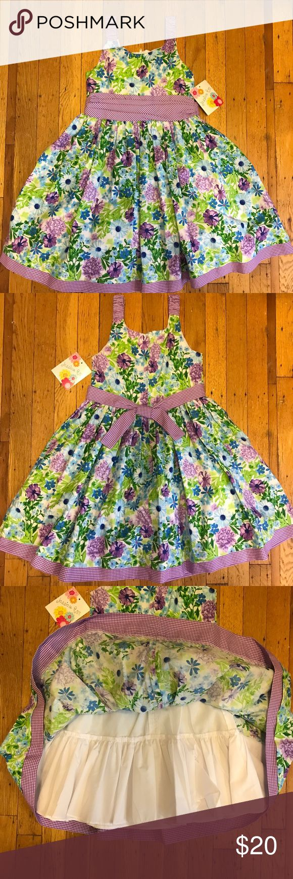 """NWT girls floral print spring dress size 6 Brand new with tags floral print girls dress. Purple sash with bow at the back. Zipper at back. Brand is Jessica Ann. Size 6. Lined skirt gives it some extra """"poof"""". Perfect for summer or spring. Jessica Ann Dresses Casual"""
