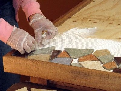 Make your own mosaic tile tabletop. No tutorial, but I think I can figure it out
