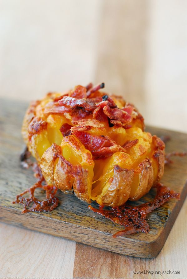 Make this Bloomin' Baked Potato recipe as a holiday side dish or party appetizer. The potato skins are crisp and salty, the insides are soft and cheesy.