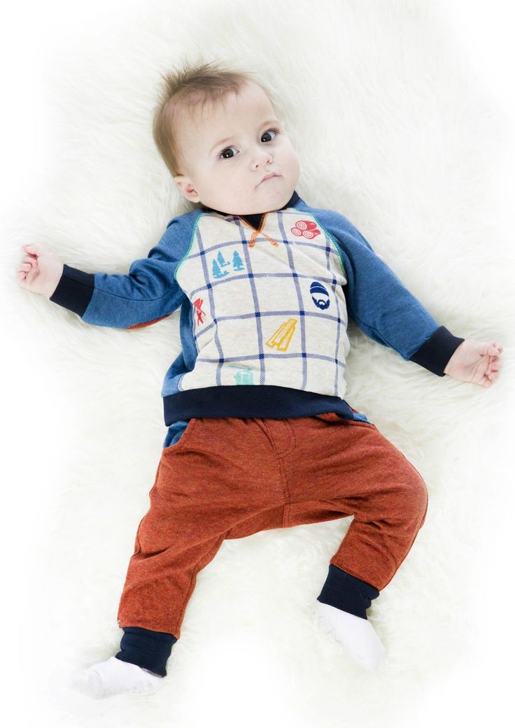 Accented with colorful lumberjack-inspired graphics, the Two-Piece Jersey Set offers cozy comfort for stylish little boys. In a soft cotton/poly jersey blend, this adorable set features a long sleeve top with contrast raglan sleeves, a plaid print body, contrast merrow stitching, and a crew neckline with snap closures at the back. See more children's clothes at DeuxParDeux.com // Deux Par Deux // kids clothes // kid style // fashion for kids
