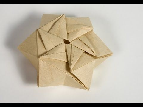 Origami - video on how to fold a StarPuff Box by ilan garibi. He has a website here: garibiorigami.com
