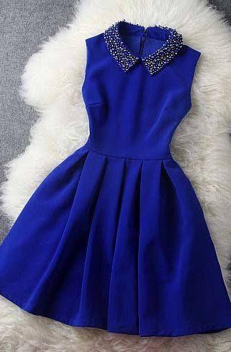 Niebieska sukienka z kołnierzykiem, rozkloszowana, elegancka