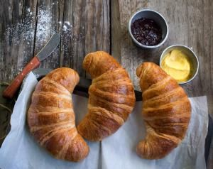 croissants with butter and jam - twomeows/Moment Open/Getty Images