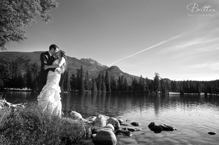 Bride and Groom by the Lake in Jasper, Alberta. Photo by Britton Photography