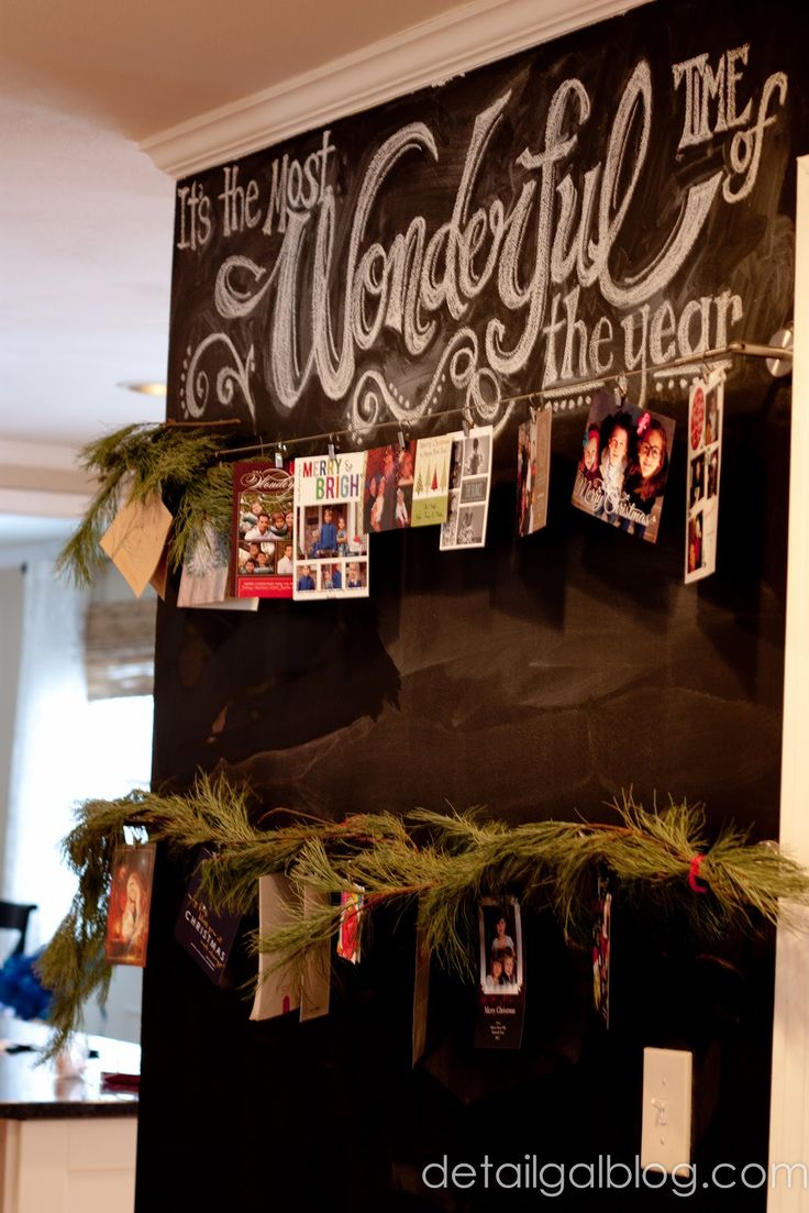 www.detailgal.com shares a chalkboard wall Holiday Card Display, simply using wires, fresh pine garland