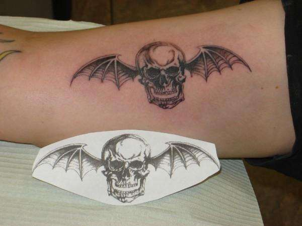 I want my death bat tattoo with a cute purple bow on its head! and i'll have my favorite A7X lyrics too :)