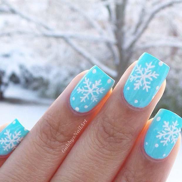 23 Latest Winter-Inspired Nail Art Ideas: #15. LIGHT BLUE SNOW AND SNOWFLAKE NAILS; #nailart; #naildesign