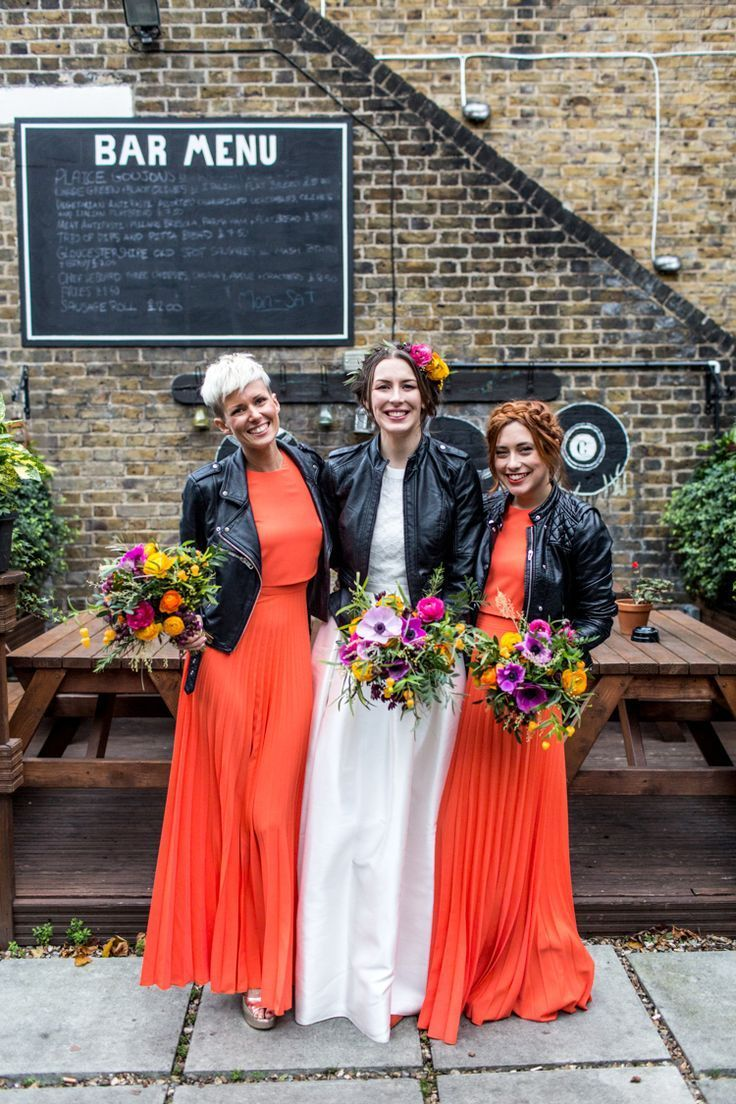 Cool Indie City Wedding With Leather Jackets Dinosaurs Alternative Bridesmaid Dresses Alternative Bridesmaid Coral Dress Outfit [ 1104 x 736 Pixel ]