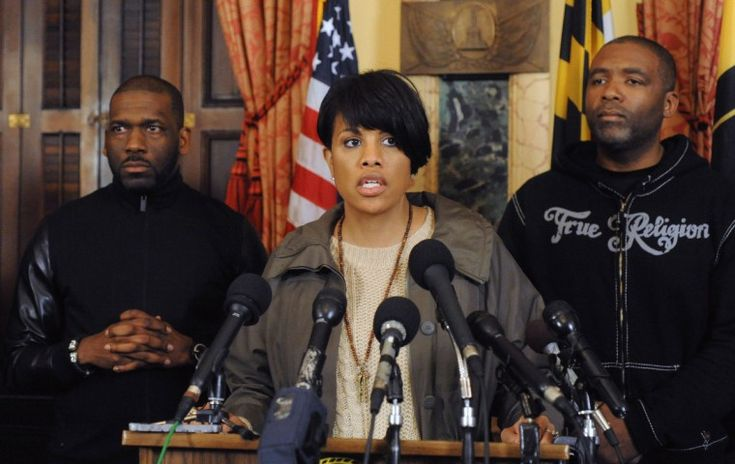 Mayor Stephanie Rawlings Blake holds a press conference at City Hall to talk about the unrest in the wake of a march to protest the death of Freddie Gray.  Standing with her is, right, Dr. Jamal Bryant, Empowerment Temple, and, left, Dr. Donte Hickman, Sr., Southern Baptist Church.  (Algerina Perna/Baltimore Sun)