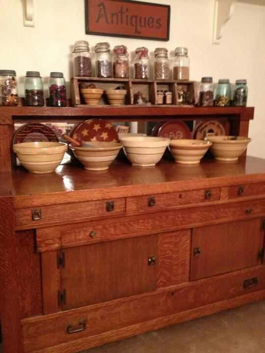 Old Sideboard...with yellow ware bowls and mason jar collection.