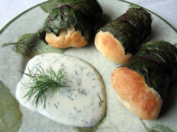 Mennonite Girls Can Cook: Beet Leaf Rolls. One of my very favorites- although during the last few minutes of baking I pour cream boiled with finely chopped fried onions, garlic and dill and serve warm- heavenly!