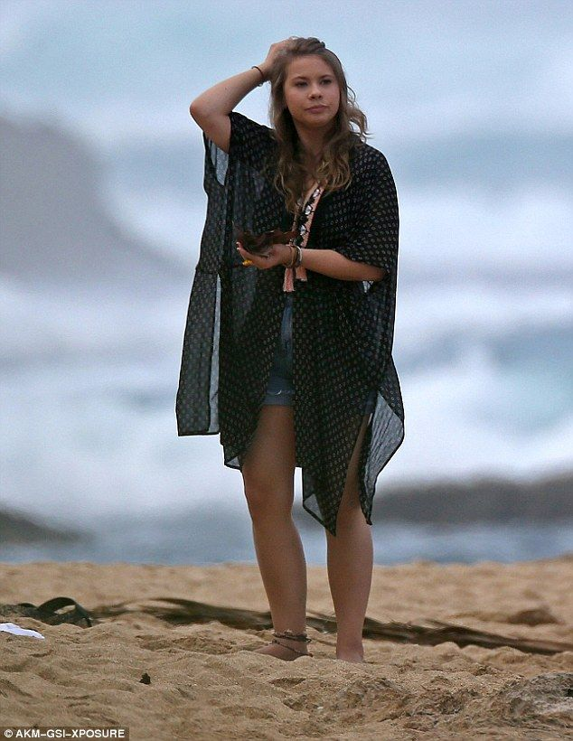 Relaxed: She later donned a light black kaftan and was seen staring wistfully out to sea
