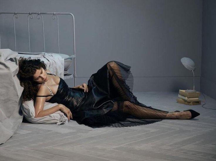 Dressed in black, Laetitia Casta poses in Dior dress
