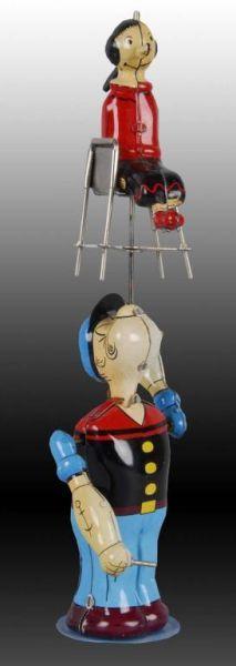 Lot # : 1318 - Linemar Juggling Popeye & Olive Oyl Toy.