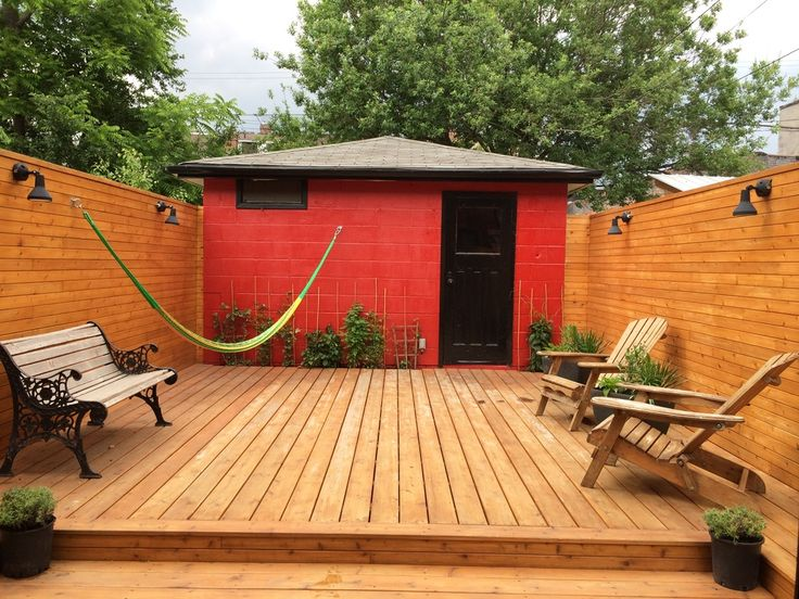 Custom Cedar deck with dimming lights, leading to a large garage