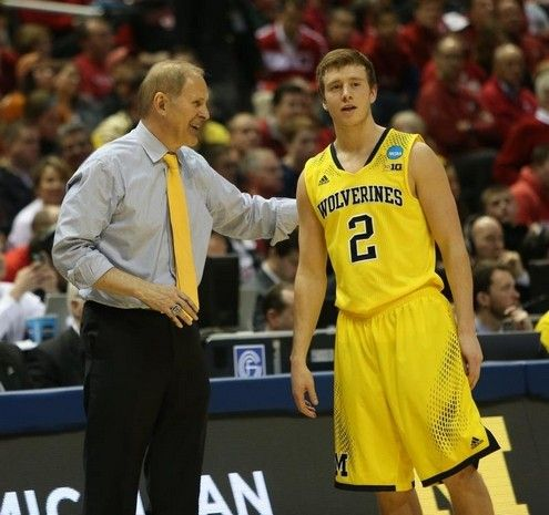 Michigan head coach John Beilein talks with Spike Albrecht during second half action against Texas in their third round NCAA Tournament game Saturday, March 22, 2014 at BMO Harris Bradley Center in Milwaukee, Wisconsin.