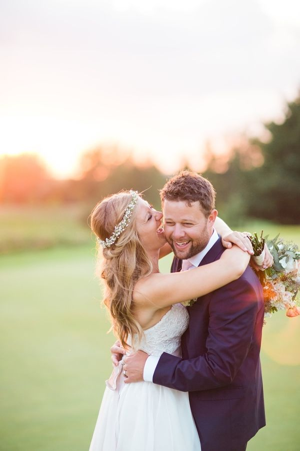 This pair's happiness is contagious! http://www.stylemepretty.com/wisconsin-weddings/middleton-wisconsin/2015/09/14/rustic-romantic-garden-inspired-wisconsin-wedding/ | Photography: Booth Photographics - http://boothphotographics.com/