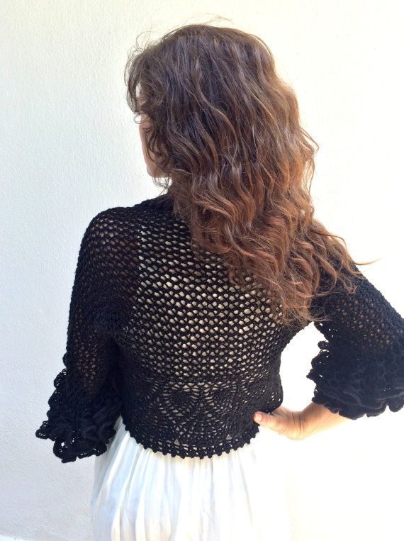Black bolero shrug,knitted lace bolero,crochet black bolero.   MATERİAL:  Yarn: Alize 95% Acrylic, 5% Metalic   MEASUREMENTS: ( unstretched,flat)  cuff to cuff : 42 (108 cm) back width: 25 (65 cm)    SIZE: S/M/L   CARE INSTRUCTIONS:  Hand wash or Machine wash by itself on delicate setting in lukewarm water with liquid detergent (no bleach). Lay flat to dry. Made in smoke-free and pet-free home.   Thank you for visiting my shop