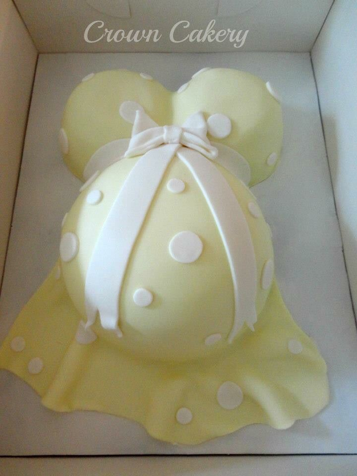 Gender reveal baby bump cake for a baby shower