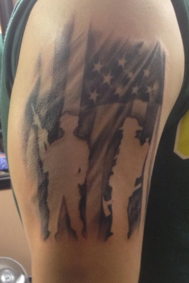 My arm tattoo. I am a soldier in the army, and a firefighter.