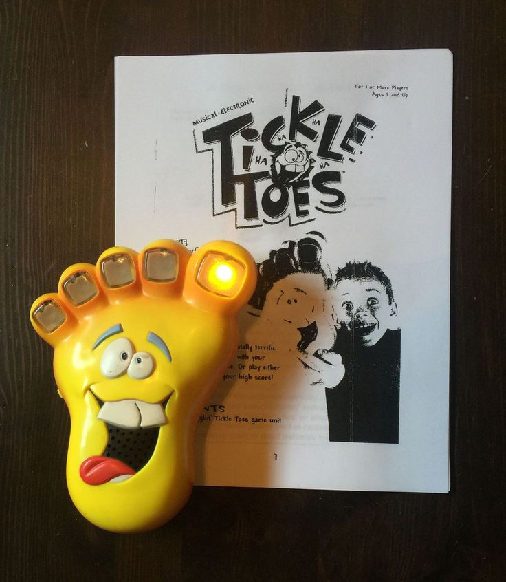 TICKLE TOES Electronic Handheld Game Wigglin Gigglin Funny Foot Game & Manual