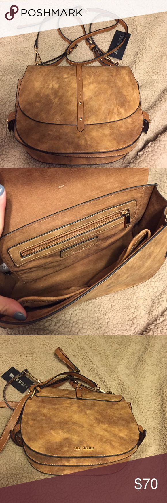 Steve Madden crossbody bag This crossbody bag is so cute! I was cleaning out my closet and noticed this purse still had the tags on it. I love the color and size, but not sure if it's my style. Steve Madden Bags Crossbody Bags