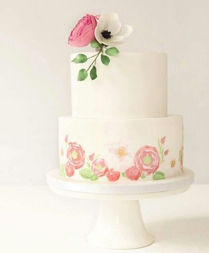 Hand-painted pink and white wedding cake with handmade sugar flowers.