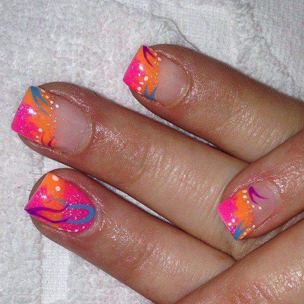 neon pink and orange with stripes & dots diagonal french tips nail art design